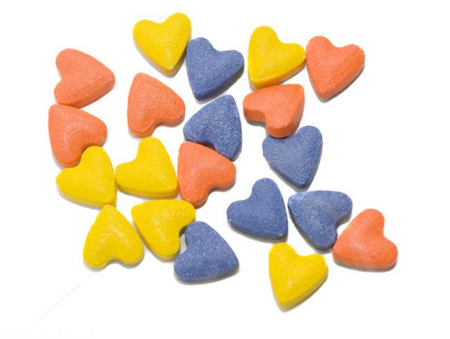 Разноцветные витаминки в виде сердечек для кошек