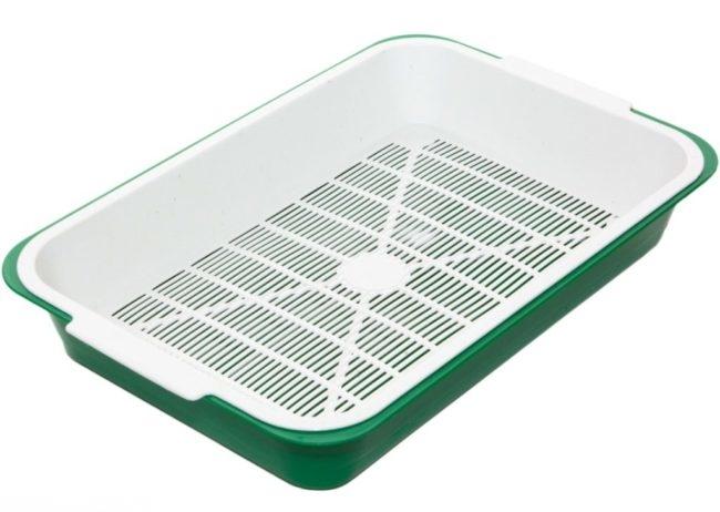 Зеленый пластмассовый чистый лоток для кошки